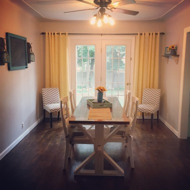 After: Refinished hardwood floors, added new furniture, curtains, and farmhouse decor.